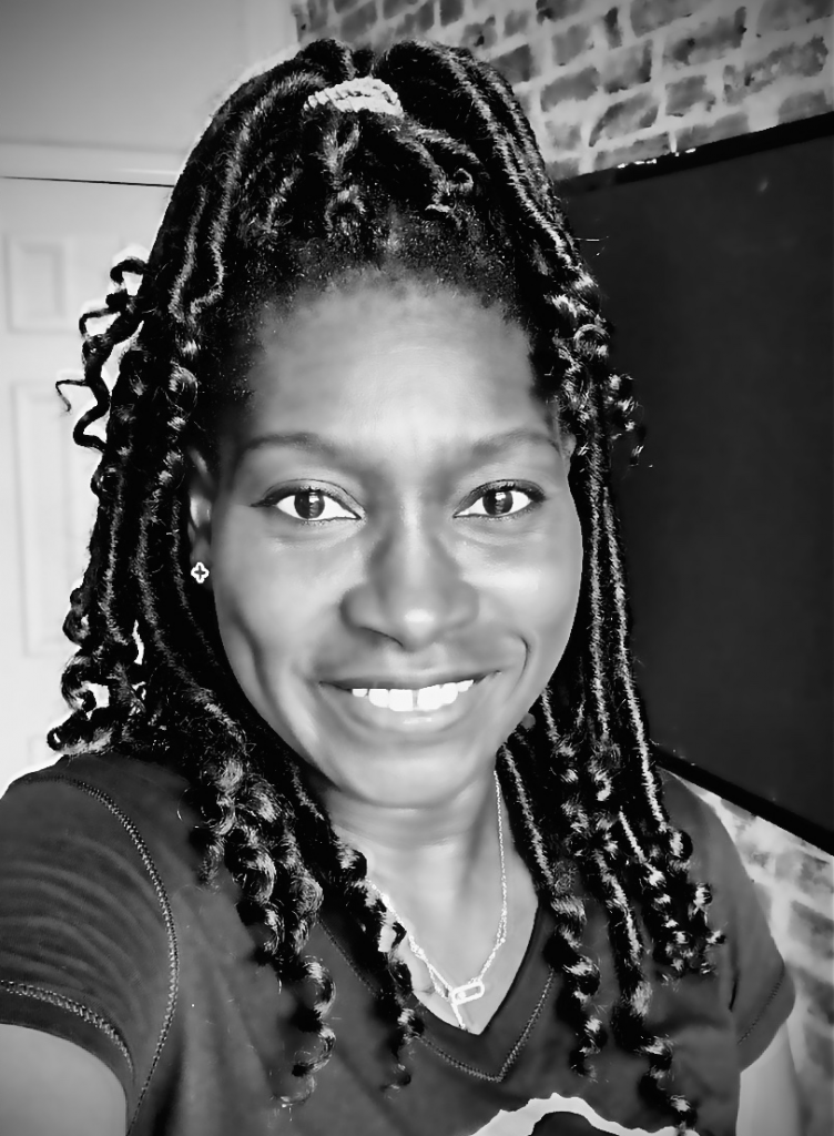 Black and white picture of Makeda Phillander in crochet goddess locs in high pony hairstyle